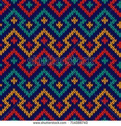 Knitting seamless geometric pattern in red, blue, orange and turquoise colours as a fabric texture