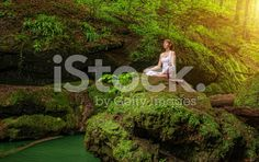 Woman in relaxation pose at Ardha Padmasana royalty-free stock photo