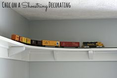 MUST incorporate Grandpa Dennis' train! DIY HO Train track shelf around room ceiling by Chic on a Shoestring Decorating Train Bedroom, Train Nursery, Boys Train Room, Ideas Para Organizar, Toy Rooms, Kids Rooms, Model Trains, Toy Trains, New Room