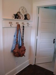 Hooks on top of beadboard wainscot. Patina White blog----could do in laundry room with door knobs instead of hooks