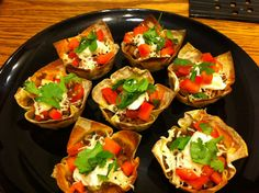 Perfect for a party! Taco bites: Put wonton wrappers in a muffin pan, fill with meat and cheese, bake at 425 for eight minutes. Then fill with the rest of the toppings! Perfect for a party!