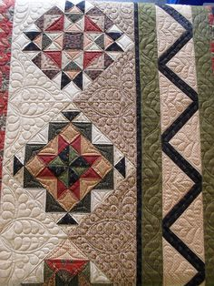 I used to just notice the design of the quilt until I started machine quilting.  Now I notice the quilting too.  Both are pretty in this one!