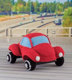 crochet vw beetle pattern from the book Honk! Beep! Vroom! All of the patterns in this book are designed to be cars that actually move for playtime!