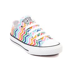 Shop for Youth Converse All Star Lo Multi Chevron Sneaker in White Multi at Journeys Kidz. Shop today for the hottest brands in mens shoes and womens shoes at JourneysKidz.com.Gettin down on the Lo with a zig zaggin color explosion! Its the exclusive kids edition low top Converse All Star Multi Chevron, featuring a multicolored chevron print canvas upper and classic All Star rubber outsole. Available exclusively at Journeys KidzI! Available for shipment in February; pre-order yours today!
