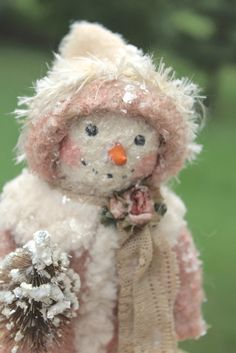 A pink, sparkly, vintage inspired snowman!