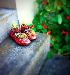 Do you have any old shoes from your kids left in a closet somewhere? Use them as very cute little planters!  Cover shoes with glitter or use high heels old work boots