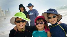Family on beach sun protection clothing Image from www.rch.org.au