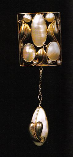 Brooch with pendant, designed by Josef Hoffmann and made by Wiener Werkstatte, ca.1912. Gold and mother-of-pearl