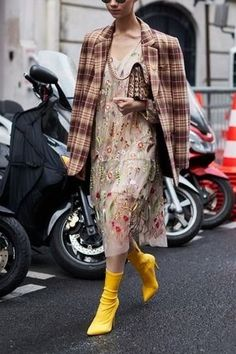 Loving the layer of this gorgeous holiday dress with unconventional coat.. and these yellow boots are everything!