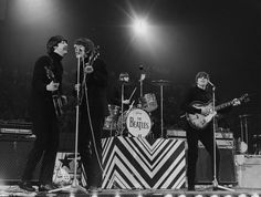 the Beatles on stage in concert in 1966 at Wembley by Herman Selleslags