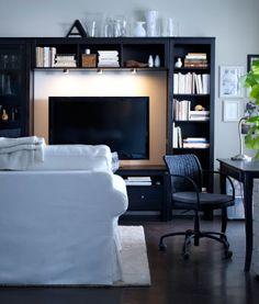 IKEA living room store display; beige sofa, white furniture, layered ...