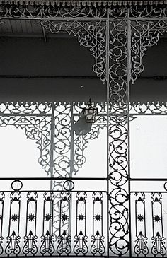 Intricate, ornate styling of the wrought-iron grillwork used in balconies adorning the architecture throughout New Orleans' famed French Quarter....