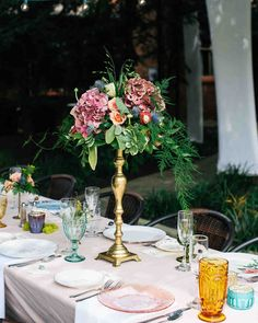 The Prettiest Place Settings from Real Celebrations   Martha Stewart Weddings – This eclectic tablescape featured a range of unique dishes, from translucent pink plates to floral ones.