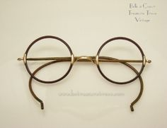 1920s Round Rim Windsor Celluloid Eye Glasses $60.00  Windsor style round rim eye glasses. Frame poss. celluloid/Zyl. The round rims are a dark brown color while the arms are gold. The arms curve behind the ears to hold them in place. Nice nose bridge.