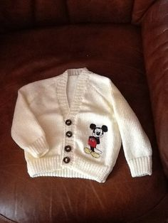 Hand knitted baby cardigan with Mickey Mouse by Happilyevercrafts, £12.00