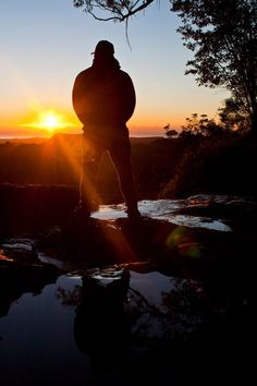 Springbrook National Park, Gold Coast hinterland, QLD    Standing at the top of a waterfall watching the sunrise over the Gold coast....