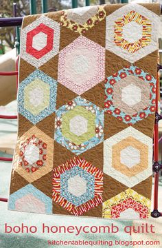 Boho Honeycomb Quilt « Moda Bake Shop by Erica Jackman Moda's new honeycomb pre-cut and this is a fun, quick way to put them to good use. There are no Y seams involved and it yields a generously sized lap quilt. Quilting Tips, Quilting Tutorials, Quilting Projects, Sewing Projects, Modern Quilting, Hexagon Quilting, Quilting Designs, Jellyroll Quilts, Lap Quilts