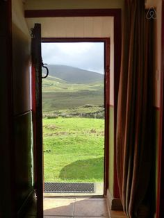 view from the door of a restored traditional Irish cottage in the countryside of Co. Donegal