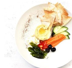 Deli Hummus Served With Feta Cheese, Cucumber, Olives, Tomato And Pita Bread!