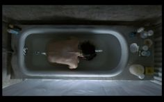 """Screen shot from Requiem for a Dream by Darren Aronofsky. In the spirit of Warhol's ideal, """"Good artists borrow, great artists steal,"""" Aronofsky bought the rights to the anime, Perfect Blue by Satoshi Kon in order to remake the bath scene in Requiem for a Dream."""