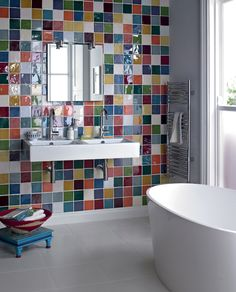 Bathroom with a checkerboard of colourful tiles