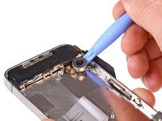 2. Haga palanca en el vibrador hasta liberarlo del adhesivo de fijación al iPhone.