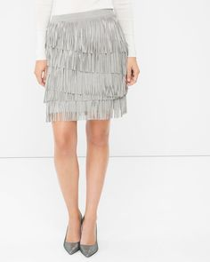 """Full-on fringe and sumptuous suede—we just can't get enough of this 70s trend. Done here in a skirt that goes with everything from shimmering blouses to cable knit sweaters. Flirty movements welcome.   Silver fringe suede skirt Back zip Sits 1"""" below natural waist and hits 3-4"""" above the knee Approx. 19"""" center back length 100% suede. Professional leather clean only.  Imported"""