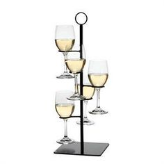 This Wine Flight Server will help you navigate wine flight presentation with the greatest of ease. The Amelia Wine Flight Server holds up to 5 wine glasses vertically. The Amelia Flight Server is a restaurant-quality wine rack built to carry enough wine for an entire table of winos. The sturdy wrought iron construction and solid but unobtrusive base ensure the flight will stay upright. A slotted ring on top is perfect for carrying your wine or adding a card to name your flight or its…