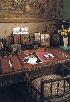 Twilight Tide. Rustic desk. Books. Old photos. Nook. Where one creates.