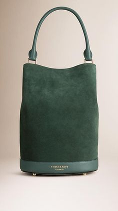 Burberry Racing Green The Bucket Bag in Suede - The Bucket Bag in English suede. Inspired by the runway, the design is made in Italy with hand-finished details. A detachable matching wristlet features inside. Discover the women's bags collection at Burberry.com
