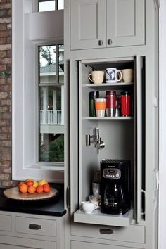 Turn a narrow cabinet into a pull out coffee station. So smart!