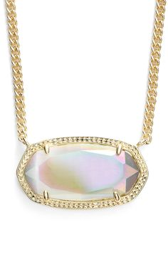 This gold and iridescent stone pendant necklace is simply dazzling.