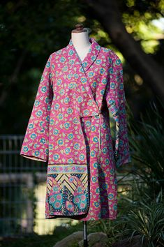 I'm having a quilted jacket moment: coats made with Kantha quilts at http://materialobsession.typepad.com