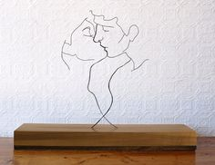 "Gavin Worth ""The Kiss"" - Steel wire and poplar, 21""x16""x5.5"" http://www.gavinworth.com/thekiss.html"