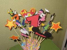 Mickey Mouse Clubhouse Centerpiece with all Disney Characters  Includes the following:  *Mickey  *Minnie   *Donald  *Daisy  *Goofy  *Pluto  *Number of your choice  *Mickey Ears w/childs name  *Toodles  *6 Two Tone Stars  $20.00