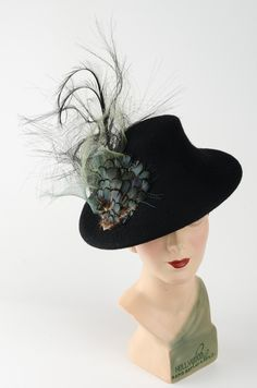 The Elspeth! This extraordinarily dramatic felt disc with an intriguing little crown which complements the lavish detailing. It has a beautiful arrangement of feathers contrasting with flourish of hand-dyed net, set off with a long double-curved feather. Colour: Black #Fabhatrix #Edinburgh #Grassmarket #Elspeth #felt #occasion #hat Fascinator, Headpiece, Colour Black, Color, Hat Pins, Flourish, Edinburgh, Tartan, Riding Helmets