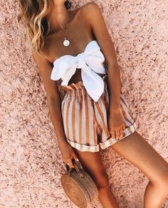 Striped shorts and white tie top. Cute summer outfit.