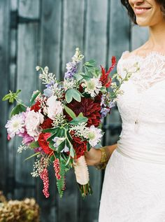 colorful bouquet with burgundy dahlia - photo by Justin Tearney http://ruffledblog.com/collaborative-pennsylvania-farm-wedding