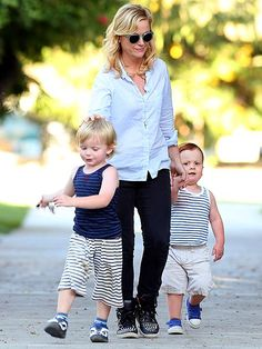 Amy Poehler and her boys. A red head and a blonde. Too cute!