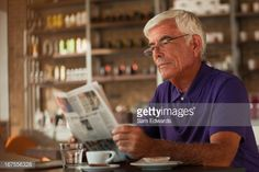 Stock Photo : Man reading newspaper in cafe