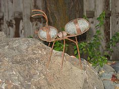 metal and stone ant on rock