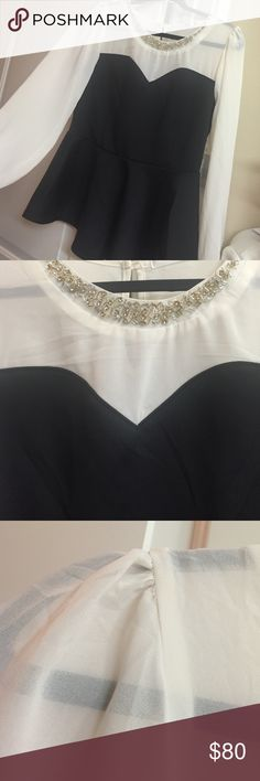 Black and white long sleeve rhinestone peplum top Black and white Long sleeve rhinestone peplum top. Brand new with tags plus size 1x sweetheart neckline. Very flattering! Tops Blouses