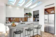 This stunning kitchen by Pycon Homes features Wideline Fixed window splashbacks in both the main kitchen and the butler's pantry. The Velux skylights add the perfect finish touch.