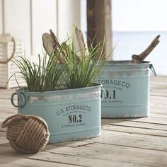 Soft aqua galvanized metal tubs with vintage lettering from CountryDoor. Use them for anything from storage to flowerpots!