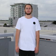 White quilted tshirt, contrast back panel with zip and ta moko maori artwork.