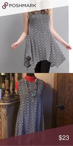 Super Soft Chevron Handkerchief Tunic Assymetrical Hemline. Super Soft material. Only worn a few times. No rips, stains,etc. 95% polyester 5% spandex. Gorgeous AND comfortable!  Reborn Dresses Asymmetrical