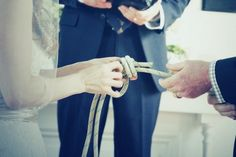 """Couple """"tying the knot"""" They tied a fisherman's knot during their ceremony. This is the strongest knot, in fact, the rope will break before the knot comes undone. The knot can be framed in a shadow box with a picture from the ceremony as a keepsake. Unity Ceremony, Wedding Ceremony, Our Wedding, Dream Wedding, Trendy Wedding, Wedding Knot, Wedding Stuff, Wedding Photos, Ceremony Seating"""