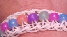 "Rainbow Loom : ""The Bead Ladder"" bracelet.  http://m.youtube.com/watch?v=LoYXrD6aXpA_uri=%2Fwatch%3Fv%3DLoYXrD6aXpA"