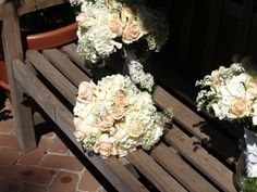 Roses, hydrangea and baby's breath bridesmaids' bouquets