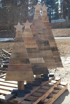 Pallet Christmas trees with hand cut star on top and built in tree stand on the bottom.  I made two 4ft and two 3ft trees.